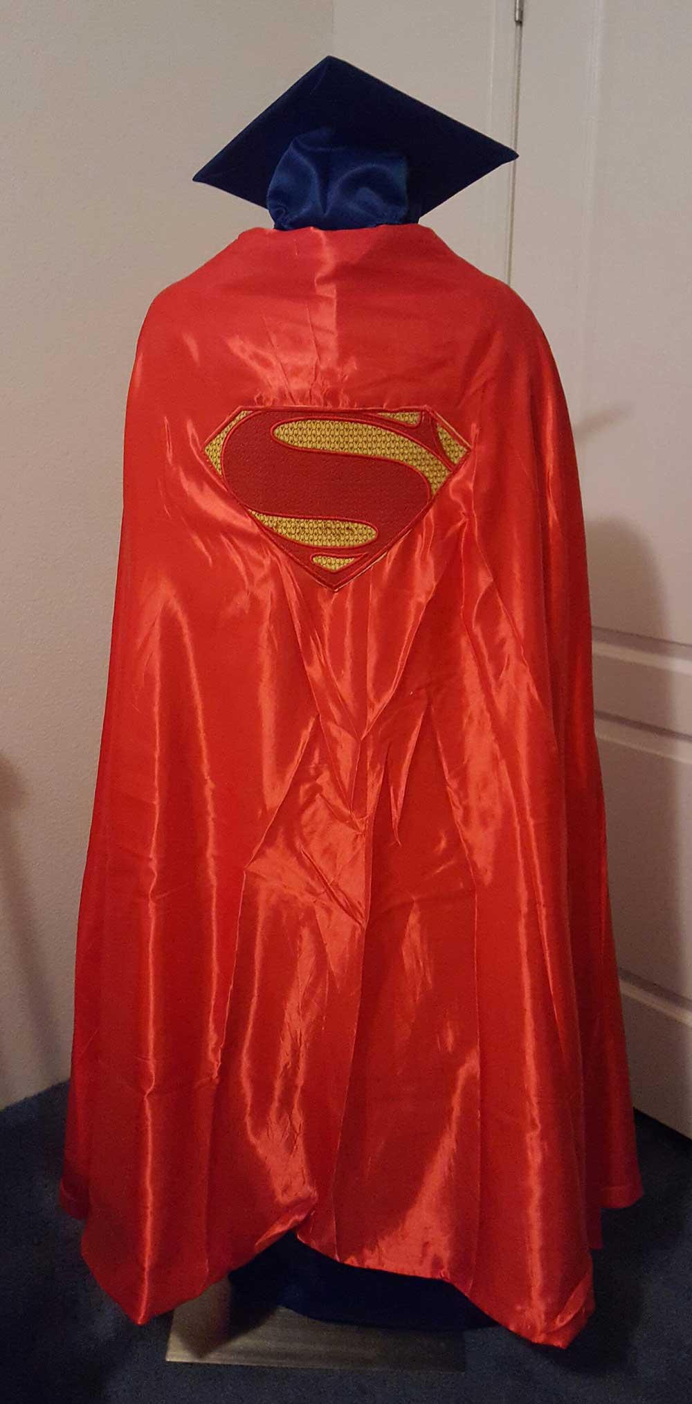 AE-GCG Superman Back Optional Cape Camo Graduate (image)
